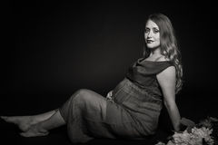 Beautiful pregnant woman on a dark background Royalty Free Stock Photos