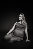 Beautiful pregnant woman on a dark background Royalty Free Stock Photography