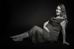 Beautiful pregnant woman on a dark background Royalty Free Stock Image