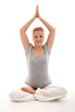 Beautiful pregnant woman doing exercises Stock Photography