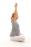 Beautiful pregnant woman doing exercises Royalty Free Stock Photos