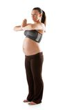 Beautiful pregnant woman doing exercises Royalty Free Stock Photography