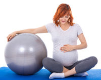 Beautiful pregnant woman doing exercises with fitball isolated o. N white background Stock Image