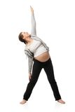 Beautiful pregnant woman doing exercises Stock Images