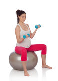 Beautiful pregnant woman doing sport royalty free stock photo