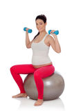 Beautiful pregnant woman doing sport Royalty Free Stock Images