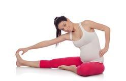 Beautiful pregnant woman doing sport stock photos