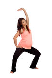 Beautiful pregnant woman doing stretching Royalty Free Stock Photo