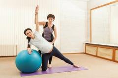 Beautiful pregnant woman doing yoga