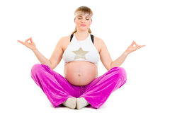 Beautiful pregnant woman doing yoga exercises Stock Photos