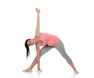 Beautiful pregnant woman doing yoga Royalty Free Stock Photo