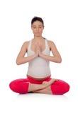 Beautiful pregnant woman doing yoga Stock Photography