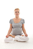 Beautiful pregnant woman doing yoga relaxation Royalty Free Stock Image
