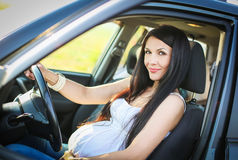 Beautiful pregnant woman driving Royalty Free Stock Image