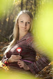 Beautiful pregnant woman eating candy  lollipops. Royalty Free Stock Images