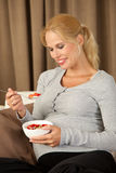 Beautiful pregnant woman eating healthy. Beautiful pregnant woman having a very healthy lunch Royalty Free Stock Photo