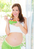 Pregnant woman eating salad Stock Photography