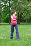 Beautiful pregnant woman exercising Stock Photo