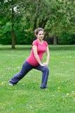 Beautiful pregnant woman exercising Stock Image