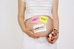 Beautiful pregnant woman expecting concept. Expecting concept tags on sticker notes about pregnancy and babies stock photo