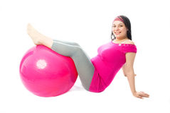 Beautiful pregnant woman with a fitness ball Royalty Free Stock Photography