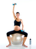 Beautiful pregnant woman at fitness gym Royalty Free Stock Photo