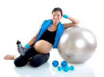 Beautiful pregnant woman at fitness gym relaxed Stock Photo