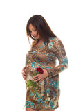 Beautiful pregnant woman with flower Stock Photography