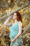 Beautiful pregnant woman in the garden Royalty Free Stock Photos