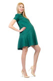 Beautiful pregnant woman in green dress isolated Royalty Free Stock Photos