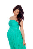 Beautiful pregnant woman with green dress Royalty Free Stock Image