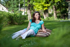Beautiful pregnant woman on green grass Stock Photography