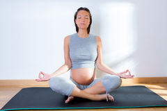 Beautiful pregnant woman at gym fitness yoga Royalty Free Stock Photography