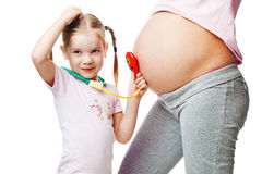 Beautiful pregnant woman with her daughter Stock Image