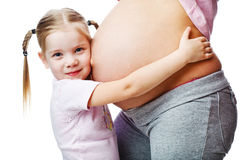 Beautiful pregnant woman with her daughter. Royalty Free Stock Photo
