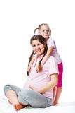 Beautiful pregnant woman with her daughter Stock Photography
