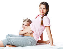 Beautiful pregnant woman with her daughter Stock Photos