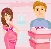 Beautiful pregnant woman and her happy husband on shopping Royalty Free Stock Photos