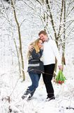 Beautiful pregnant woman and her husband outdoors Stock Photography