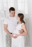 Beautiful pregnant woman and her husband Stock Images