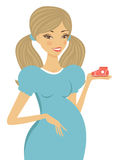 Beautiful pregnant woman holding baby shoe Royalty Free Stock Images