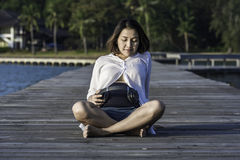 Beautiful pregnant woman holding headphones Stock Photo