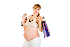 Beautiful pregnant woman holding shopping bags Royalty Free Stock Photos