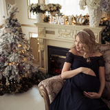 Beautiful Pregnant Woman In A Holiday Dress. Stock Photo
