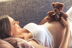 Beautiful pregnant woman at home Stock Images