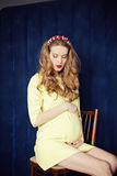Beautiful pregnant woman at home portrait Stock Image
