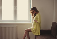 Beautiful pregnant woman at home portrait Royalty Free Stock Photography