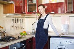Beautiful pregnant woman at kitchen Stock Image