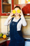 Beautiful pregnant woman at kitchen with orange Stock Image