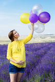 Beautiful pregnant woman in the lavender field Royalty Free Stock Photos